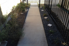 avery-ranch-townhomes-the-greens-luxury-condos-for-sale-back-walkway