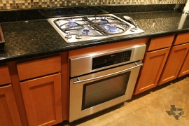 lone-star-luxury-homes-78704-kitchen-gas-cooking